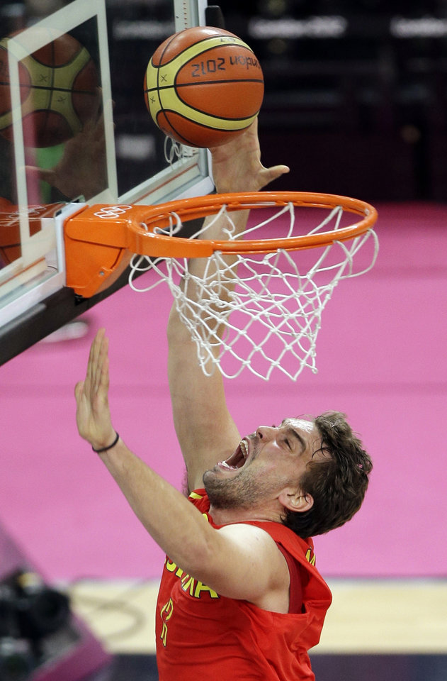 Spain's Marc Gasol puts up a shot during the men's gold medal basketball game against the United States at the 2012 Summer Olympics, Sunday, Aug. 12, 2012, in London. (AP Photo/Matt Slocum)
