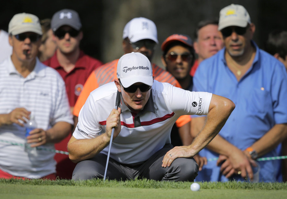 Photo - Justin Rose, of England, inspects his putt on the 15th green during the final round of the Quicken Loans National PGA golf tournament, Sunday, June 29, 2014, in Bethesda, Md. (AP Photo/Patrick Semansky)
