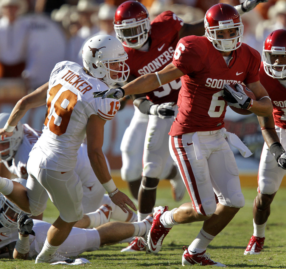 Oklahoma's Cameron Kenny (6) returns a kick past Texas kicker Justin Tucker (19) in the second half of the Red River Rivalry college football game between the University of Oklahoma Sooners (OU) and the University of Texas Longhorns (UT) at the Cotton Bowl on Saturday, Oct. 2, 2010, in Dallas, Texas.   Photo by Chris Landsberger, The Oklahoman