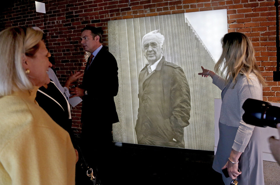 A crowd, including John E. Kirkpatrick's grandson Chris K. Keesee, at left, pass by a newly unveiled portrait of John E. Kirkpatrick.  PHOTO BY BRYAN TERRY, THE OKLAHOMAN