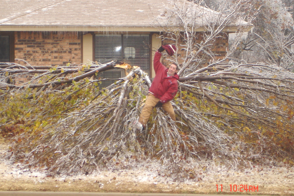 Josh Allison of MWC trying to tame the icy limb of a downed Bradford Pear. Mighty cold saddle!<br/><b>Community Photo By:</b> Rick Allison<br/><b>Submitted By:</b> Rick , Midwest City