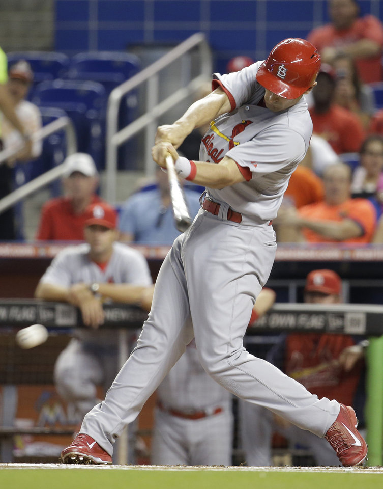 Photo - St. Louis Cardinals' Matt Carpenter hits a single in the first inning during a baseball game against the Miami Marlins, Wednesday, Aug. 13, 2014, in Miami. (AP Photo/Lynne Sladky)