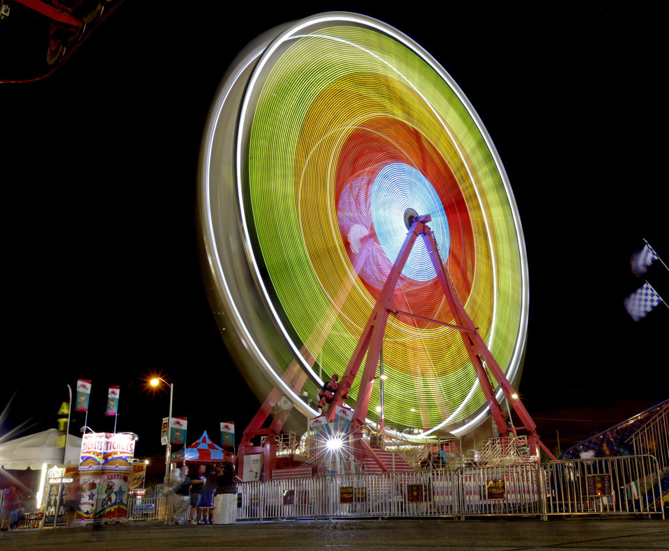 The Ferris wheel spins after sunset at the Oklahoma State Fair in Oklahoma City, Wednesday, September 19, 2012. Photo by Bryan Terry, The Oklahoman