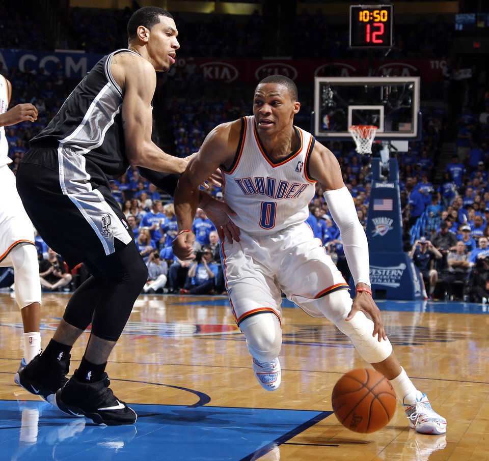 Photo - Oklahoma City's Russell Westbrook (0) drives to the basket as San Antonio's Danny Green (4) defends during Game 3 of the Western Conference Finals in the NBA playoffs between the Oklahoma City Thunder and the San Antonio Spurs at Chesapeake Energy Arena in Oklahoma City, Sunday, May 25, 2014. Photo by Bryan Terry, The Oklahoman