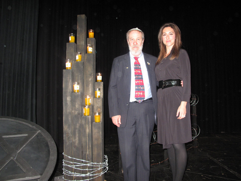 Michael Korenblit and Erielle Roodman Reshef stand beside candles lit in memory of Holocaust survivors during the 2013 Holocaust Remembrance Program Sunday at Bethany High School. The program is sponsored each year by the Jewish Federation of Greater Oklahoma City. Photo by Carla Hinton