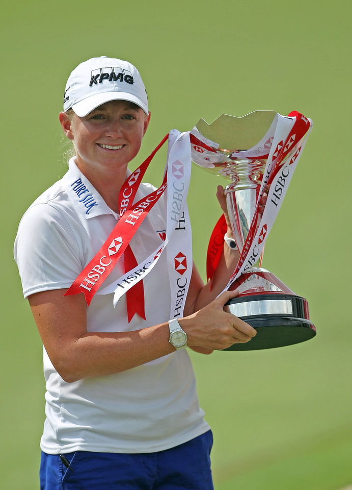 Photo - Stacy Lewis of the United States poes with the challenge trophy after winning the HSBC Women's Champions golf tournament on Sunday, March 3, 2013 in Singapore. (AP Photo/Wong Maye-E)