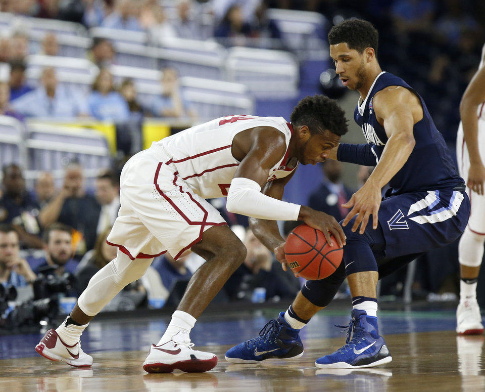 Photo - Oklahoma's Buddy Hield (24) tries to get past Villanova's Josh Hart (3) during the national semifinal between the Oklahoma Sooners (OU) and the Villanova Wildcats in the Final Four of the NCAA Men's Basketball Championship at NRG Stadium in Houston, Saturday, April 2, 2016. Photo by Nate Billings, The Oklahoman