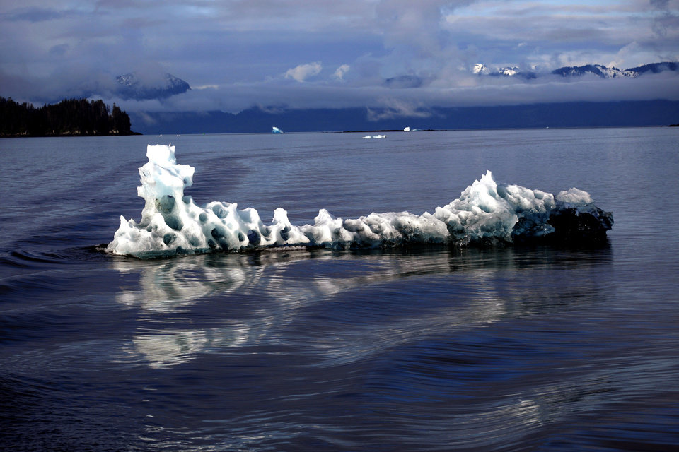 Photo - An Iceberg floats in Tracy Arm in Southeast Alaska, Sunday, June 3, 2012.  Photo by Sarah Phipps, The Oklahoman
