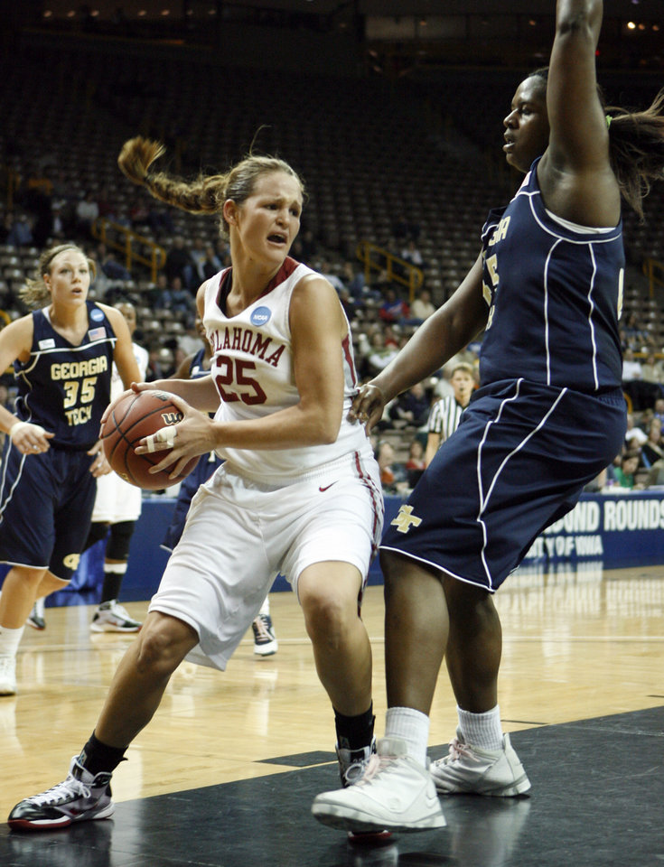 Photo - NCAA TOURNAMENT / WOMEN'S COLLEGE BASKETBALL: Whitney Hand looks for an open pass past Sasha Goodlett in the first half as the University of Oklahoma (OU) plays Georgia Tech in round two of the 2009 NCAA Division I Women's Basketball Tournament at Carver-Hawkeye Arena at the University of Iowa in Iowa City, IA on Tuesday, March 24, 2009.   PHOTO BY STEVE SISNEY, THE OKLAHOMAN ORG XMIT: KOD