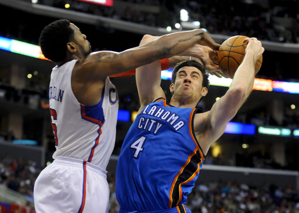 L.A. CLIPPERS: Oklahoma City Thunder forward Nick Collison (4) battles Los Angeles Clippers center DeAndre Jordan (6) as he goes to the basket in the second half of an NBA basketball game, Monday, April 16, 2012, in Los Angeles. The Clippers won 92-77. (AP Photo/Gus Ruelas) ORG XMIT: LAS109