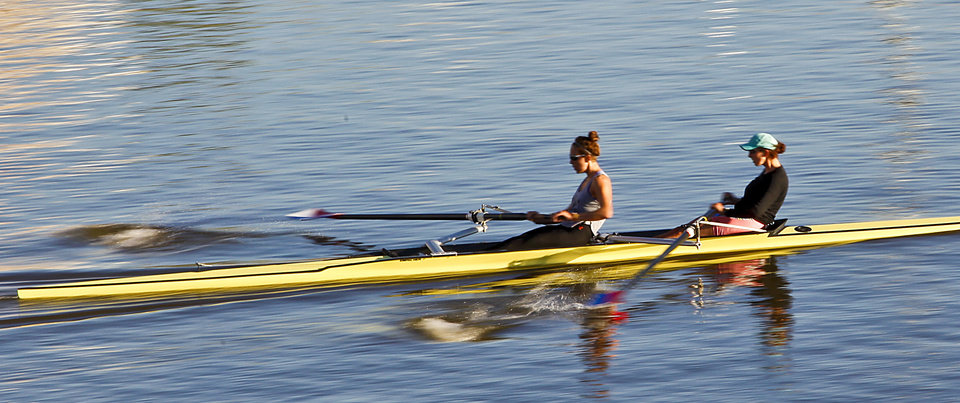 Rowing competitors streak through the water as they warm up before competition during the Oklahoma Regatta Festival at the Oklahoma River on Saturday, Oct. 1, 2011, in Oklahoma City, Okla. Photo by Chris Landsberger, The Oklahoman