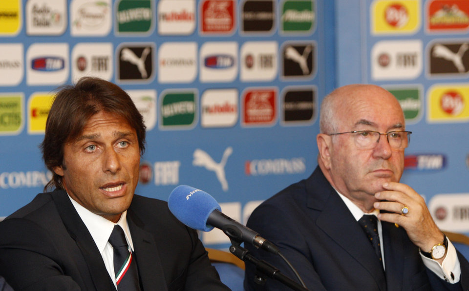 Photo - Italian national soccer team's new coach Antonio Conte, left, flanked by Italian Soccer Federation (FIGC) President Carlo Tavecchio, speak during a press conference for his presentation, in Rome, Tuesday, Aug. 19, 2014. (AP Photo/Riccardo De Luca)
