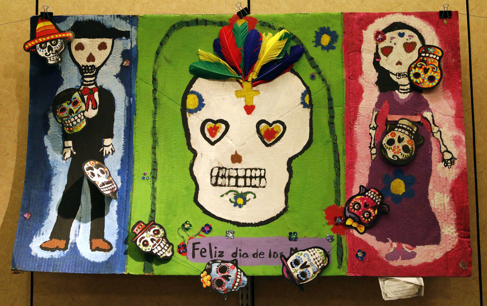 Photo - This piece by Britton Elementary students Andrea S., Perla I., and Jennifer A., from Ms. Alison Harris' class, is part of a student art exhibit commemorating Day of the Dead, on display Monday at the Plaza Mayor Fall Festival in Oklahoma City. Photo by Paul Hellstern, The Oklahoman  PAUL HELLSTERN