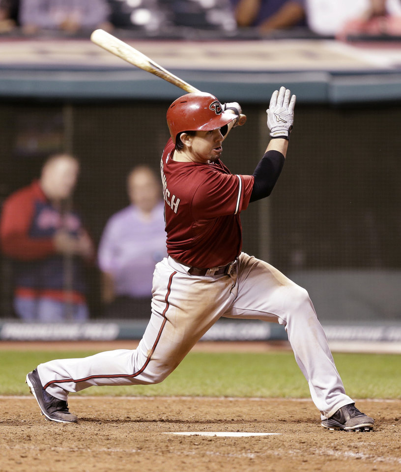 Photo - Arizona Diamondbacks' Tuffy Gosewisch hits a single off Cleveland Indians' Chen-Chang Lee in the 12th inning of the second baseball game of a doubleheader, Wednesday, Aug. 13, 2014, in Cleveland. Xavier Paul scored on the play. (AP Photo/Tony Dejak)