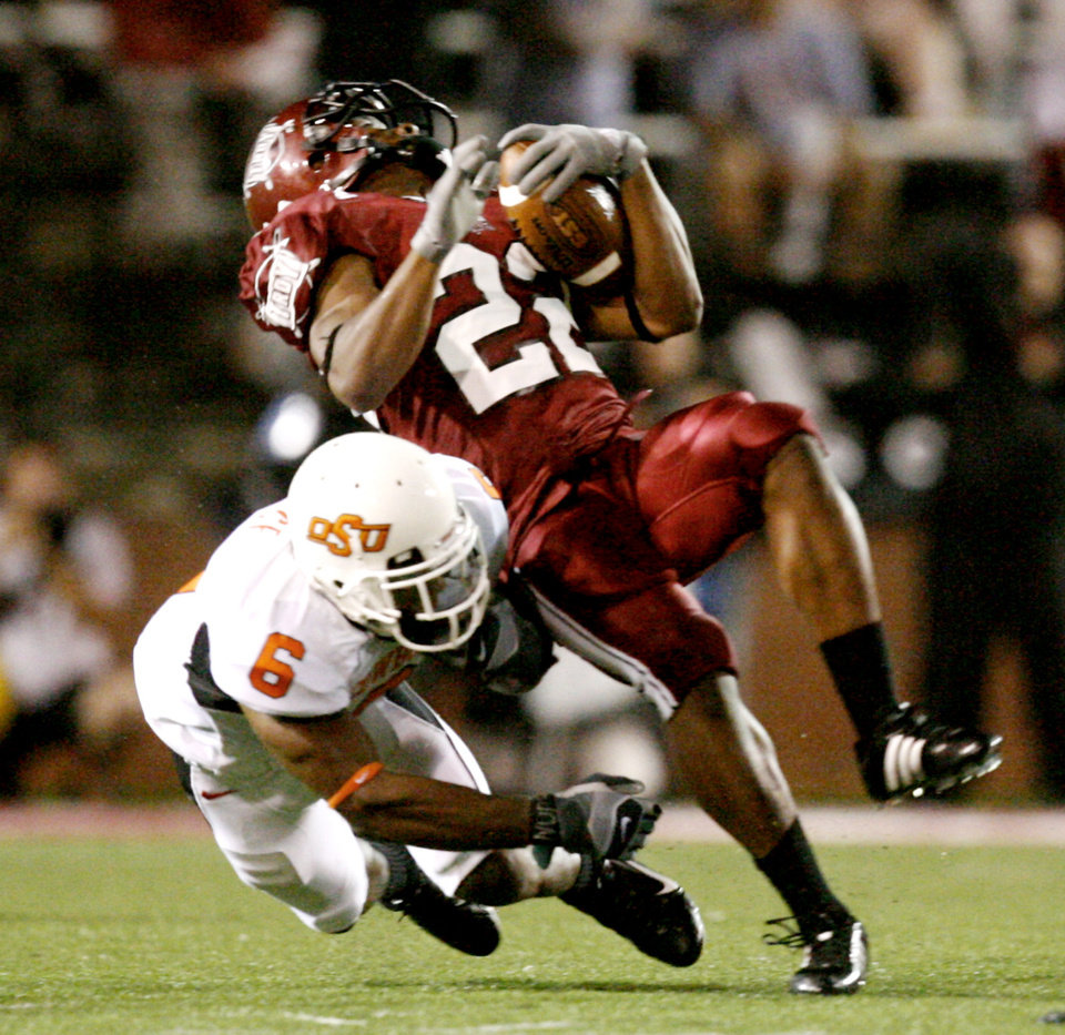 Photo - OSU's Ricky Price (6) takes down Troy's Stanley Jones in the first quarter during the college football game between the Troy University Trojans and the Oklahoma State University Cowboys at Movie Gallery Veterans Stadium in Troy, Ala., Friday, September 14, 2007. BY MATT STRASEN, THE OKLAHOMAN ORG XMIT: KOD