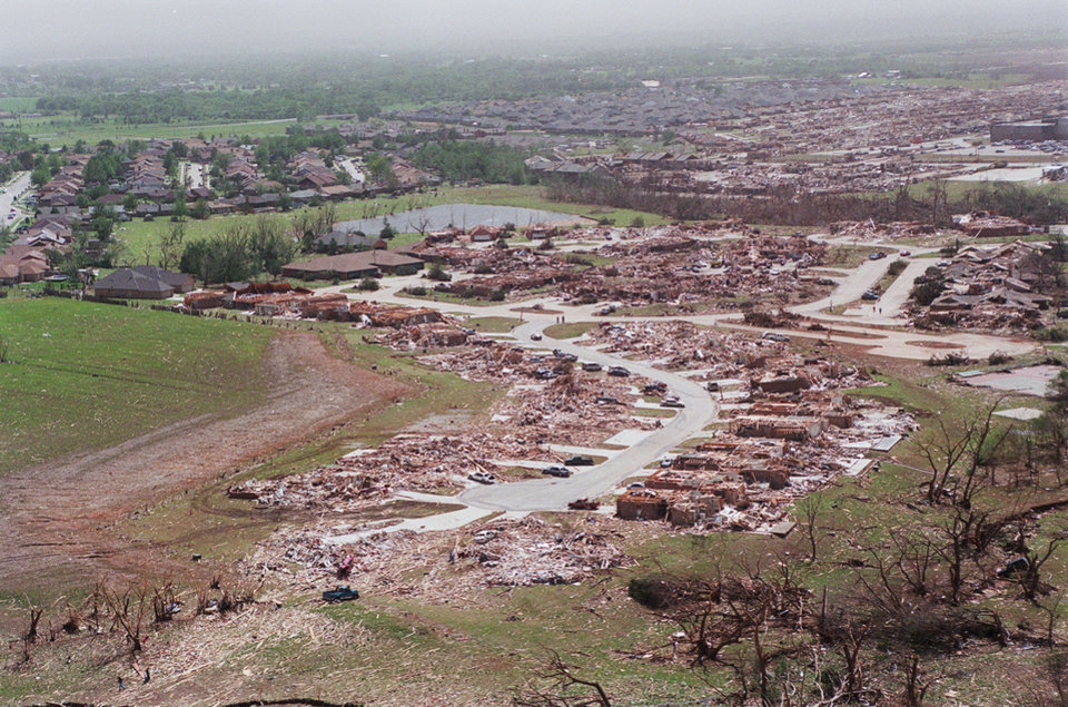 MAY 3, 1999 TORNADO: Tornado damage, aerial view: Looking southwest at housing addition in Moore, Oklahoma. At upper right is Westmoore High School