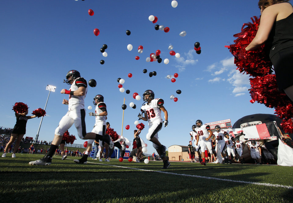 Westmoore players take the field as Moore High School and Westmoore play football on Friday, Aug. 31, 2012 in Moore, Okla.  Photo by Steve Sisney, The Oklahoman