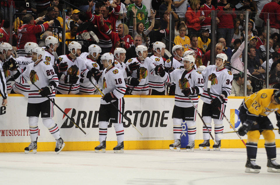 The Chicago Blackhawks celebrate a goal by Chicago Blackhawks left wing Viktor Stalberg, left,, of Sweden, against the Nashville Predators in the second period of an NHL hockey game on Saturday, March 31, 2012, in Nashville, Tenn. (AP Photo/Mike Strasinger)