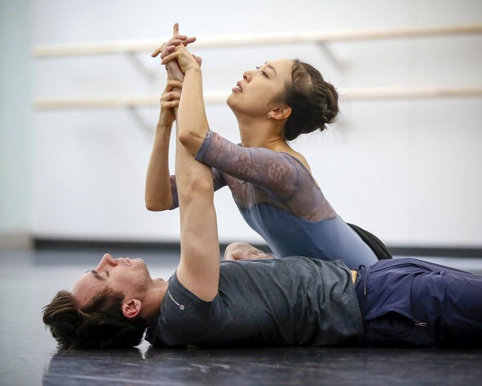 Photo - Principal dancers DaYoung Jung, right, and Alvin Tovstogray rehearse for