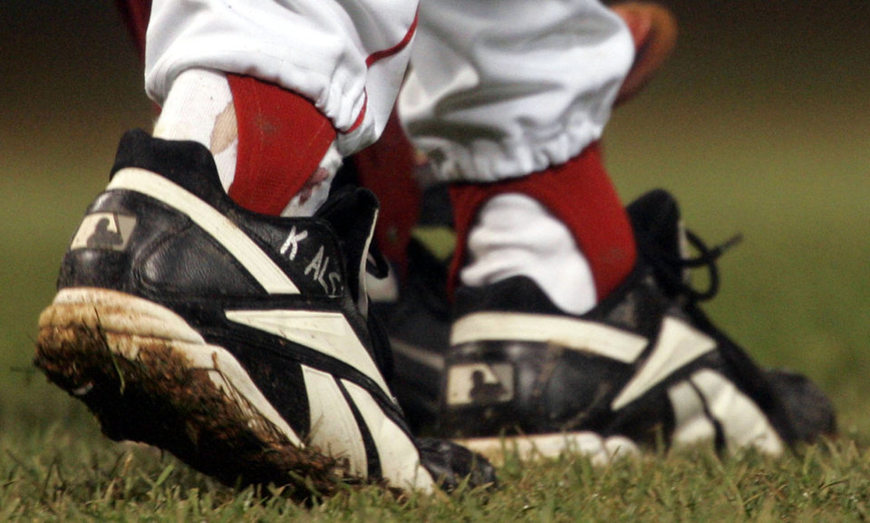 Photo - FILE - In this Oct. 24, 2004, file photo, blood appears around the right ankle of Boston Red Sox pitcher Curt Schilling during the sixth inning of Game 2 of baseball's World Series against the St. Louis Cardinals in Boston. Schilling, whose video game company underwent a spectacular collapse into bankruptcy last year, is selling the blood-stained sock he wore during that game. (AP Photo/Elise Amendola, File)
