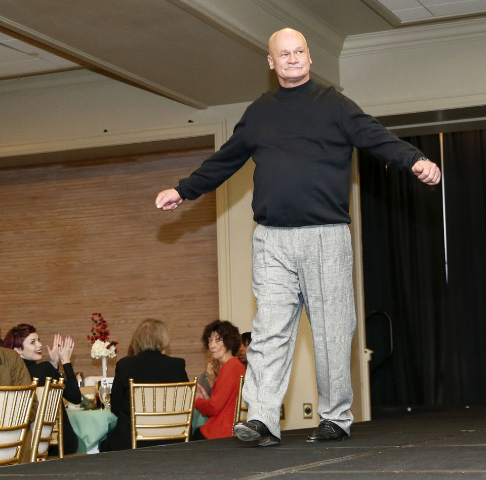 Photo -  Jimmy Little walks the runway at the