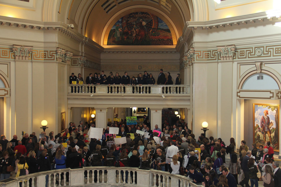 Several hundred teachers, firefighters and state employees packed the state Capitol�s fourth-floor rotunda Monday to rally against proposed changes in the state�s pension system. Photo provided.