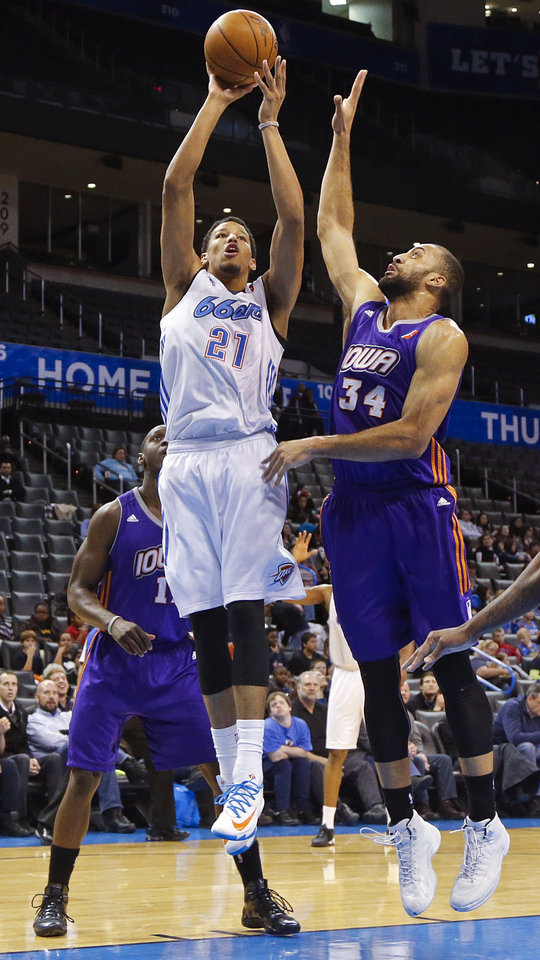 Photo - Tulsa's Andre Roberson (21) shoots the ball over Iowa's Jackie Carmichael (34) during the NBA Developmental game between the Tulsa 66ers and the Iowa Energy at the Chesapeake Energy Arena in Oklahoma City, Okla. on Tuesday, Feb. 4, 2014. Photo by Chris Landsberger, The Oklahoman