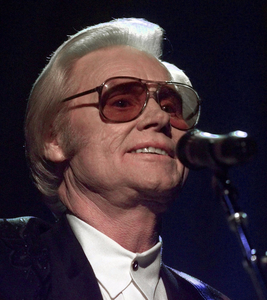 Photo - FILE - In this June 1, 1999 file photo, Country music legend George Jones is shown during a performance in Nashville.  Jones, the peerless, hard-living country singer who recorded dozens of hits about good times and regrets and peaked with the heartbreaking classic