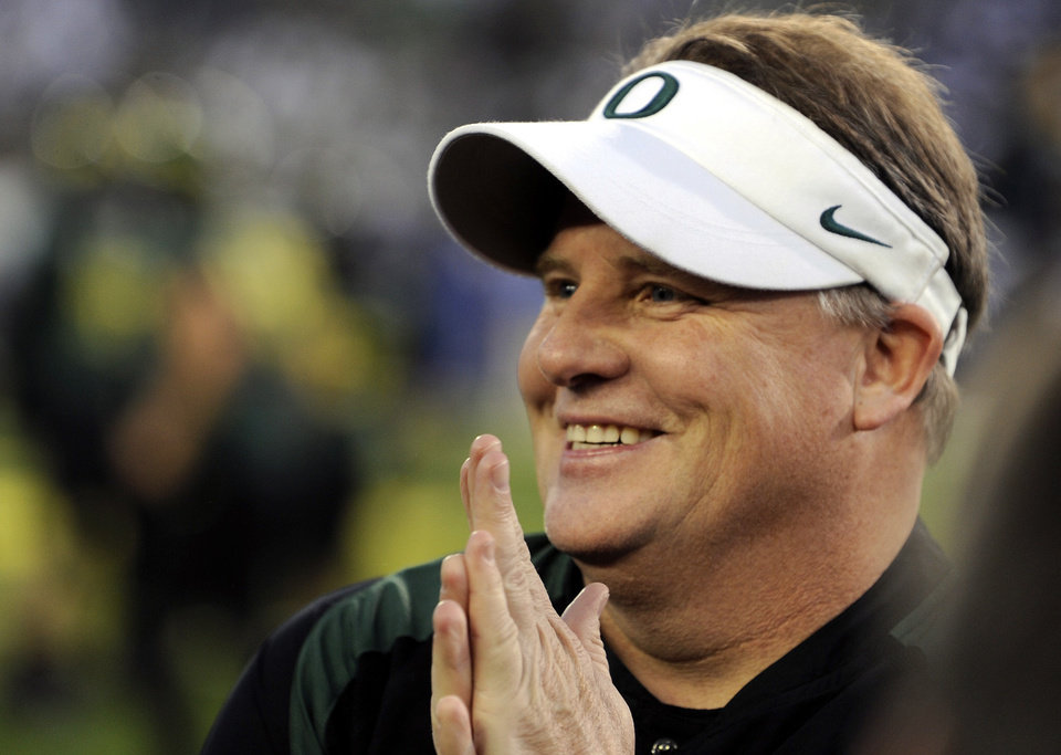 FILE - This Dec. 2, 2011 file photo shows Oregon's head coach Chip Kelly prior to the NCAA Pac 12 championship football game against UCLA in Eugene, Ore. Two people with knowledge of the decision confirmed Sunday night, Jan. 6, 2013,  that Kelly is passing up a chance to coach in the NFL to remain with the Ducks. One person spoke to The Associated Press on condition of anonymity because Oregon and Kelly haven't formally announced the decision, while the other person wasn't authorized to reveal Kelly's plans. The decision was first reported by ESPN. (AP Photo/Greg Wahl-Stephens, File)