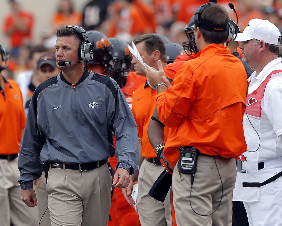 Photo - Oklahoma State head football coach Mike Gundy coaches during a college football game between Oklahoma State University (OSU) and the University of Louisiana-Lafayette (ULL) at Boone Pickens Stadium in Stillwater, Okla., Saturday, Sept. 15, 2012. Photo by Sarah Phipps, The Oklahoman