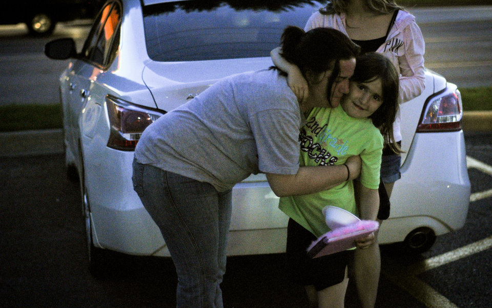 Photo - Summer Roberts is reuinted with her daughter Addyson Roberts, 7, after she has spent a day with family friends
