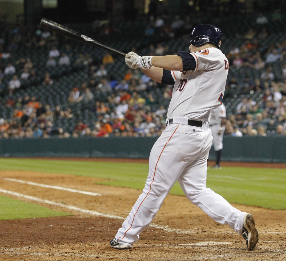 Photo - Houston Astros' Matt Dominguez hits a two-run home run in the ninth inning against the Oakland Athletics during a baseball game Tuesday, July 23, 2013, in Houston. (AP Photo/Bob Levey)