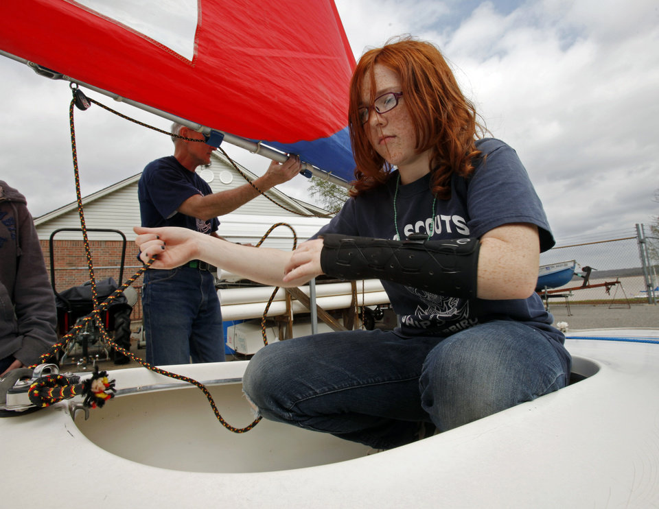 Mikaylah Cannedy, 13, rigs a sail while on land as Sea Scouts Ship 5790 conduct a sailing open house at Lake Thunderbird on Saturday, March 17, 2012, in Norman, Okla. Photo by Steve Sisney, The Oklahoman