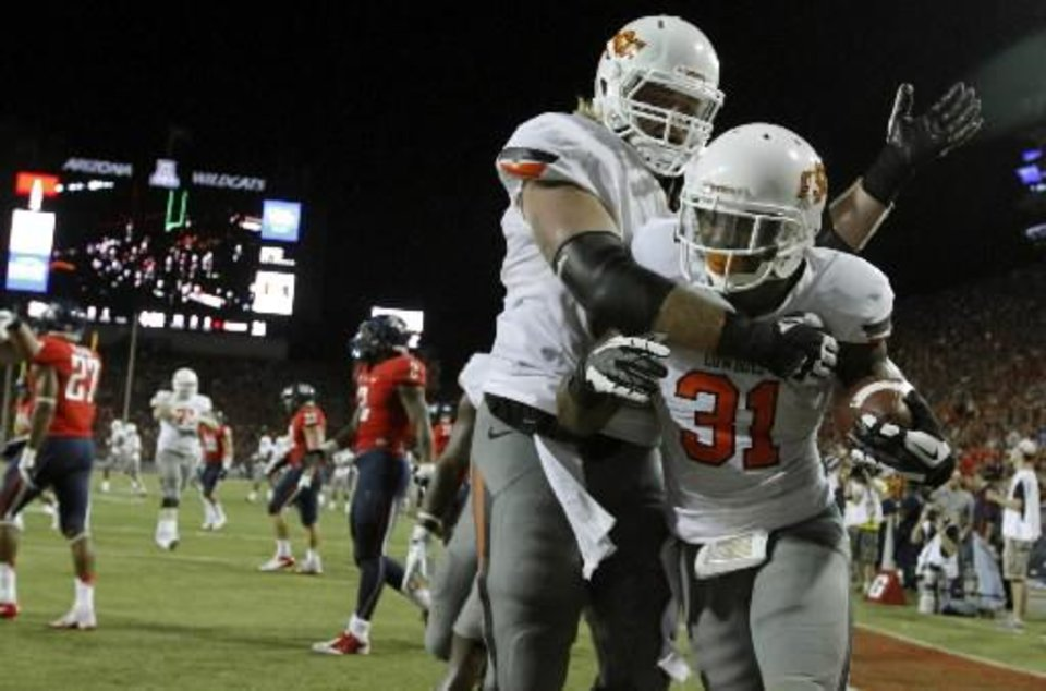 Oklahoma State's Evan Epstein (60) and Oklahoma State's Jeremy Smith (31) celebrate a touchdown during the college football game between the University of Arizona and Oklahoma State University at Arizona Stadium in Tucson, Ariz., Sunday, Sept. 9, 2012. Photo by Sarah Phipps, The Oklahoman