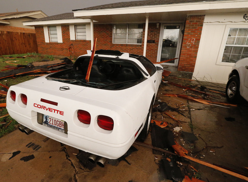 Photo - Cars with broken glass are parked on the street near SE 4th and Irving after tornado force winds on Wednesday, March 25, 2015 in Moore, Okla. Photo by Steve Sisney, The Oklahoman