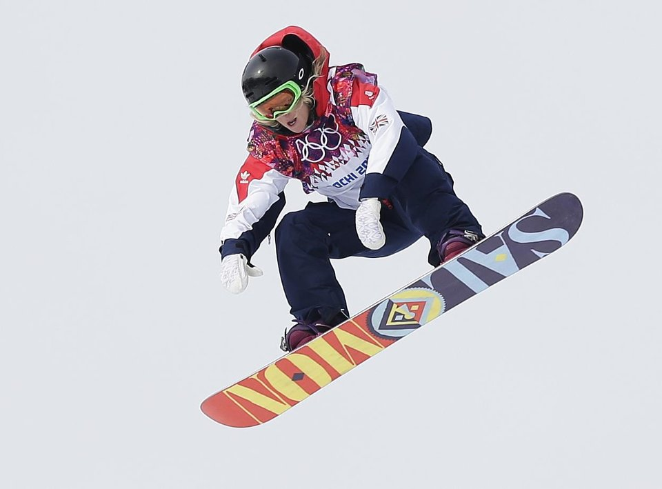 Photo - Britain's Jenny Jones takes a jump during the women's snowboard slopestyle semifinal at the 2014 Winter Olympics, Sunday, Feb. 9, 2014, in Krasnaya Polyana, Russia. (AP Photo/Andy Wong)