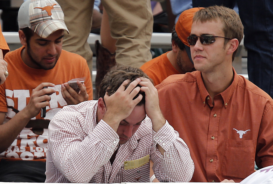 Photo - Texas fans look on in the fourth quarter of the 63-21 loss to Oklahoma during the Red River Rivalry college football game between the University of Oklahoma (OU) and the University of Texas (UT) at the Cotton Bowl in Dallas, Saturday, Oct. 13, 2012. Photo by Chris Landsberger, The Oklahoman