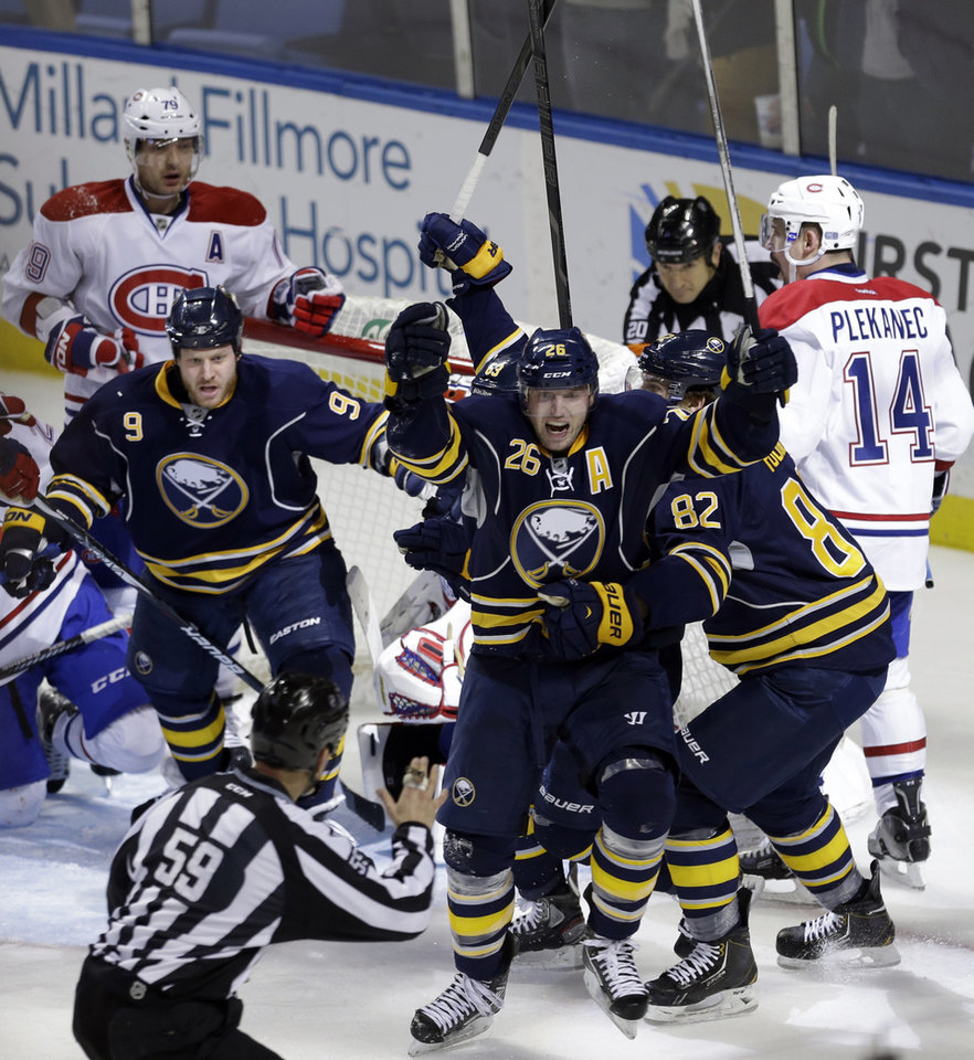 Buffalo Sabres\' Thomas Vanek (26) of Austria, celebrates his game-tying goal with seconds left against the Montreal Canadiens during the third period of an NHL hockey game in Buffalo, N.Y., Thursday, Feb. 7, 2013. The Sabres won 5-4 in a shootout. (AP Photo/David Duprey)