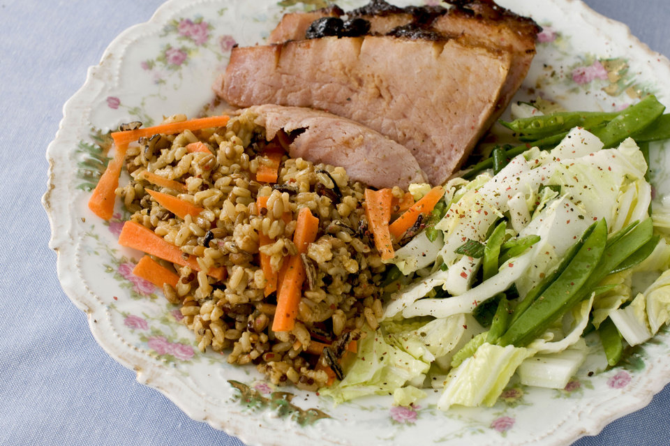 In this image taken on March 11, 2013, hoisin-glazed ham with Napa cabbage-snow pea slaw is shown served on a plate in Concord, N.H. (AP Photo/Matthew Mead) ORG XMIT: NYLS220