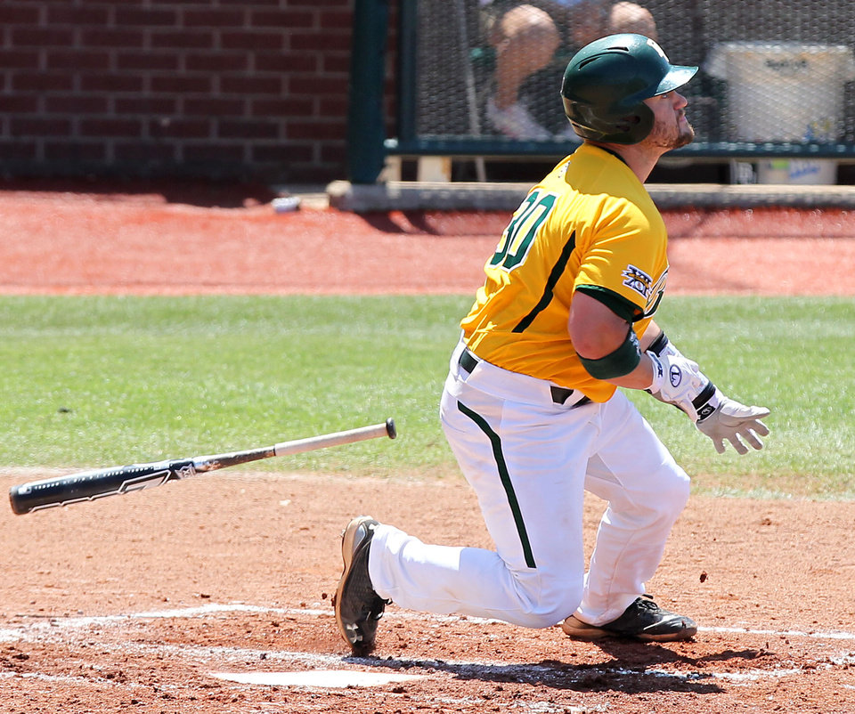 Photo - Baylor's Josh Ludy watches the ball go over the wall for a home run in the first inning of their NCAA college baseball game against Texas A&M, Sunday, April 22, 2012, in Waco, Texas. (AP Photo/Waco Tribune Herald, Jerry Larson) ORG XMIT: TXWAC102