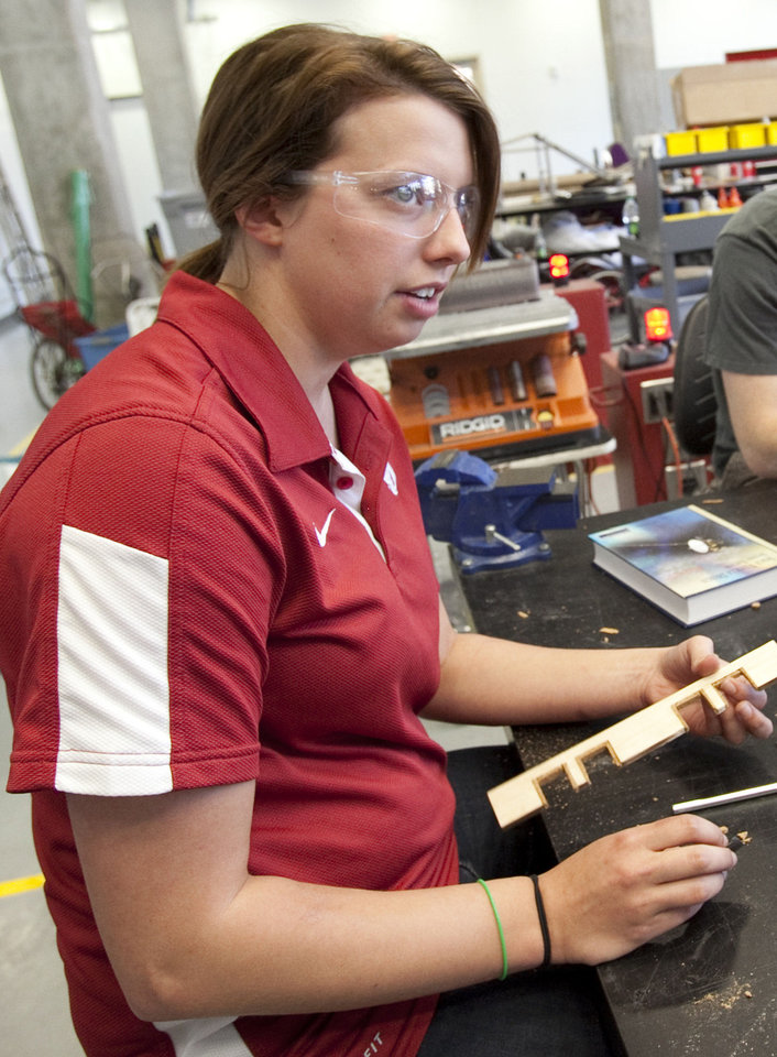 Photo - Carly Young, a senior from Paris, Ark., works on the University of Oklahoma's unmanned aerial vehicle. Photos by Steve Sisney,  The Oklahoman
