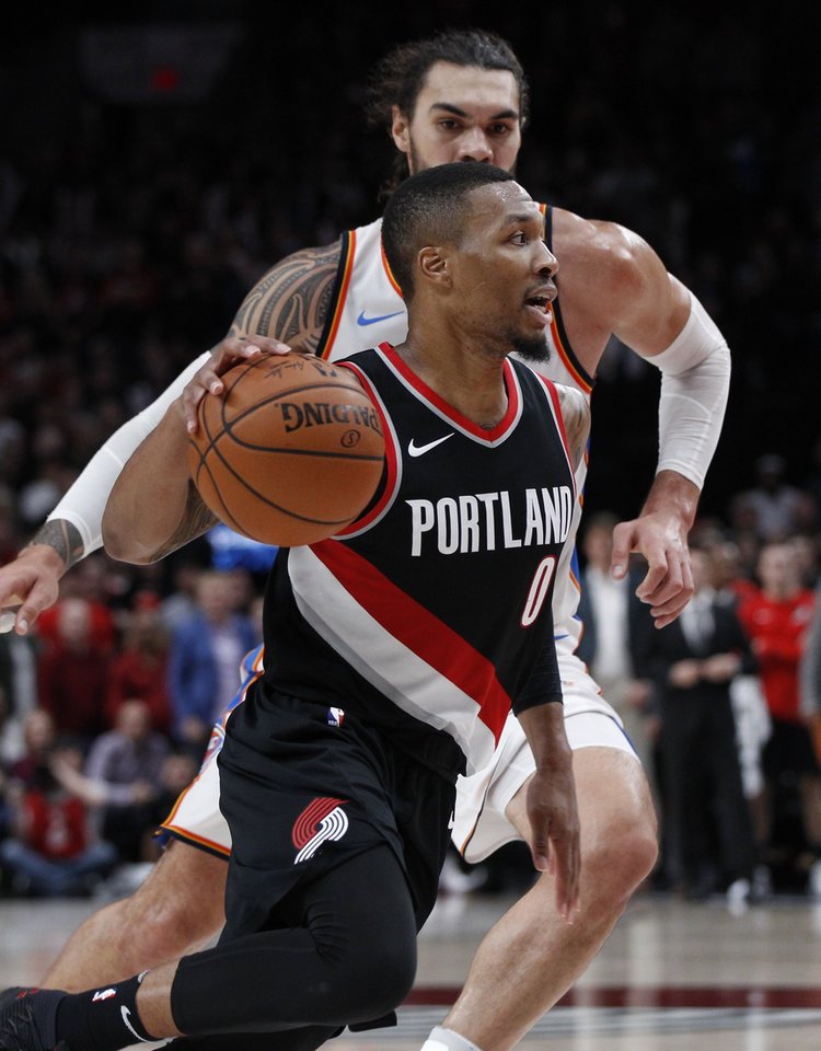 Photo -  Defensive switching means that sometimes the Thunder defends guards like Portland's Damian Lillard, front, with center Steven Adams. [AP PHOTO]