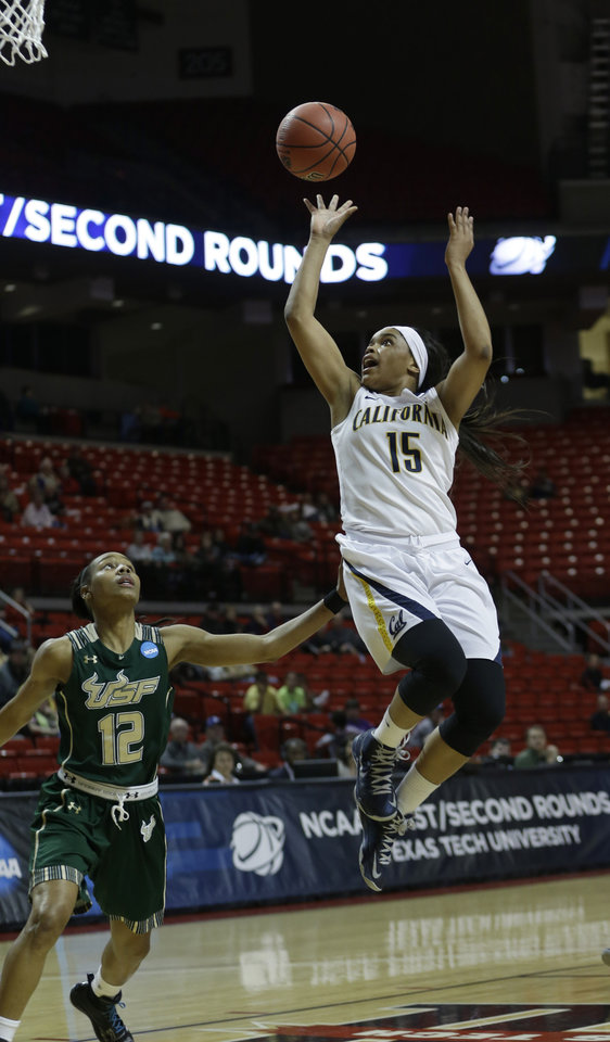 Photo - California guard Brittany Boyd (15) shoots against South Florida guard Andrell Smith (12) during the second half of a second-round game in the women's NCAA college basketball tournament in Lubbock, Texas, Monday, March 25, 2013. California 82-78 in overtime. (AP Photo/LM Otero)