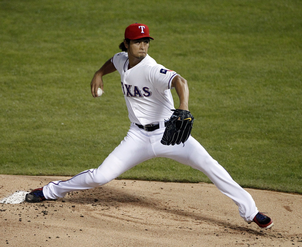 Photo -   Texas Rangers starting pitcher Yu Darvish throws to a Baltimore Orioles batter during the first inning of an American League wild-card playoff baseball game Friday, Oct. 5, 2012, in Arlington, Texas.(AP Photo/Tony Gutierrez)