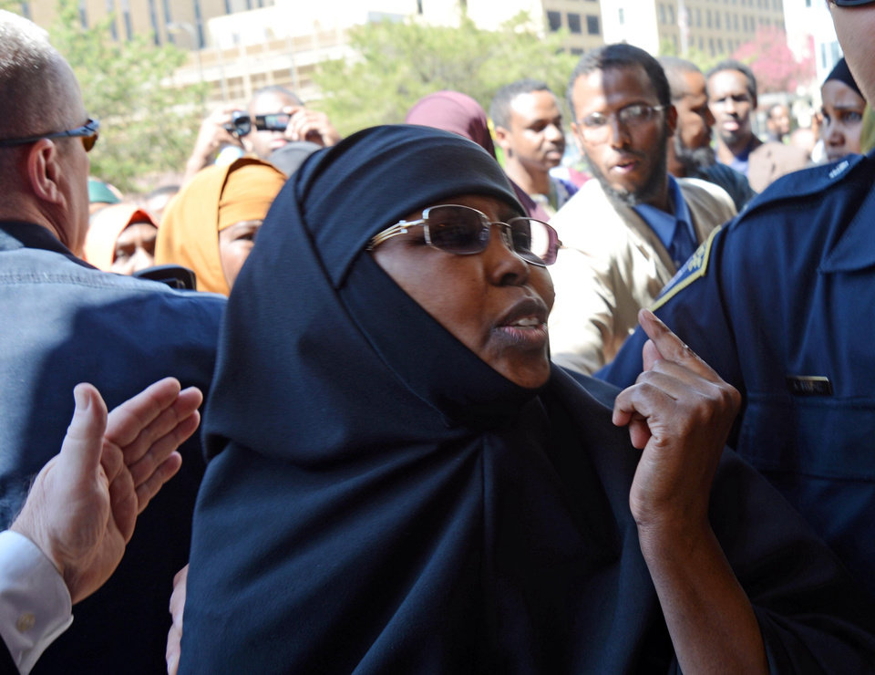 Photo - Supporters of two Somali women scheduled to be sentenced for helping a terrorist group gather outside the Hennepin County Government Center on Thursday, May 16, 2013, in Minneapolis.  Amina Farah Ali was sentenced Thursday in U.S. District Court in Minneapolis on 13 terror-related counts. Each count held a maximum penalty of 15 years in prison. Authorities say Ali and her co-defendant, Hawo Mohamed Hassan, went door-to-door raising money in the name of charity, but routed the funds to al-Shabab. (AP Photo/The Star Tribune, Richard Sennott)  MANDATORY CREDIT; ST. PAUL PIONEER PRESS OUT; MAGS OUT; TWIN CITIES TV OUT