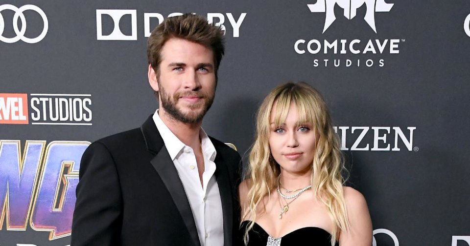 "Photo - LOS ANGELES, CA - APRIL 22:  Liam Hemsworth (L) and Miley Cyrus attend the world premiere of Walt Disney Studios Motion Pictures ""Avengers: Endgame"" at the Los Angeles Convention Center on April 22, 2019 in Los Angeles, California.  (Photo by Steve Granitz/WireImage)"