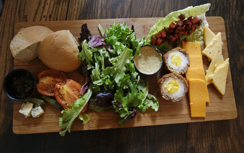 Photo - The Ploughman's Platter at the Leaky Cauldron restaurant is displayed during a preview of Diagon Alley at the Wizarding World of Harry Potter at Universal Orlando, Thursday, June 19, 2014, in Orlando, Fla. (AP Photo/John Raoux)