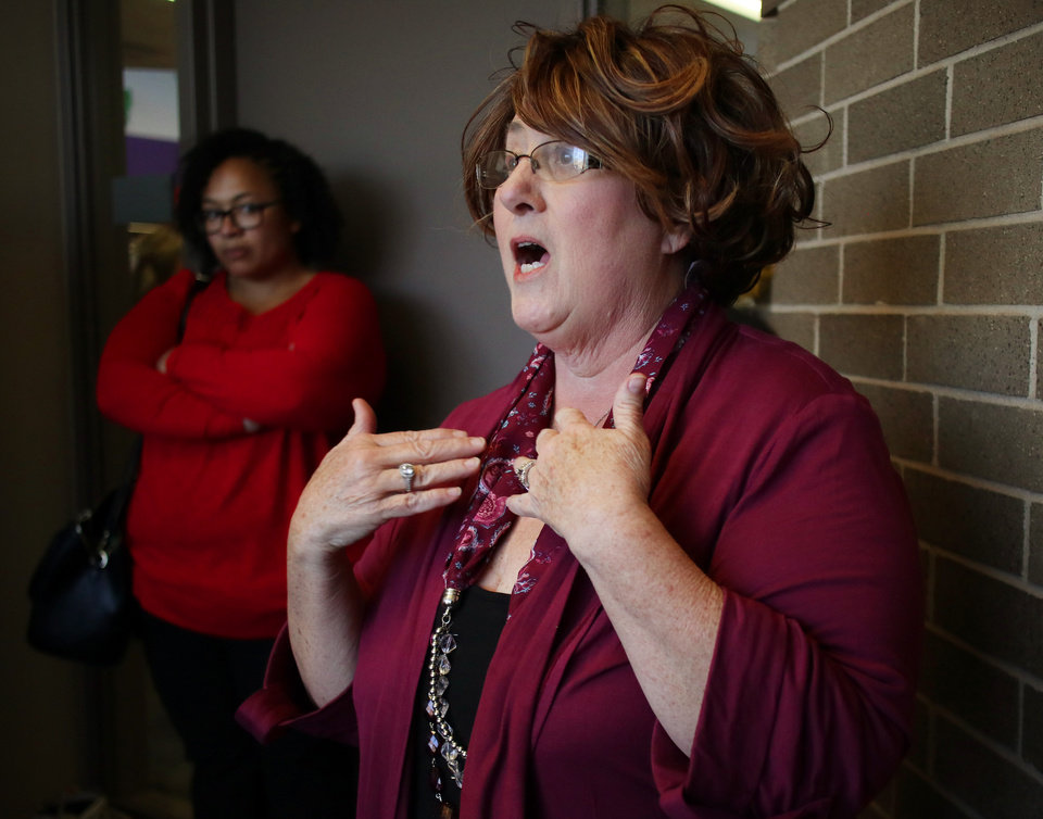 Photo - Bonnie Green, teacher at Heronville Elementary, talks about issues as teachers meet in a room at Southern Oaks Library to discus the possibility of a strike, Monday, March 5, 2018. Photo by Doug Hoke, The Oklahoman
