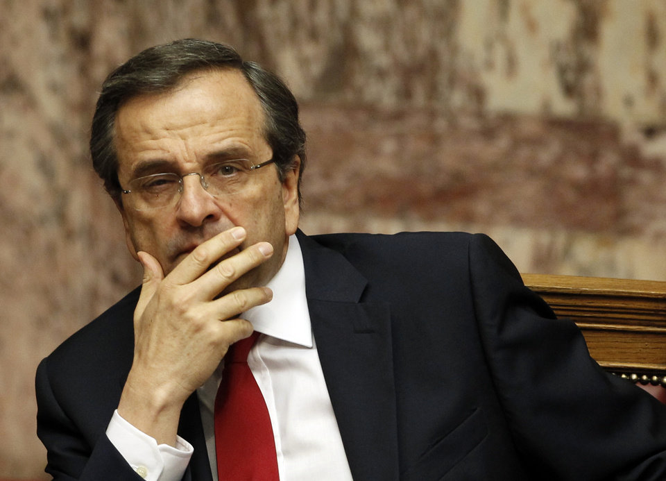 Photo -   Greek Prime Minister Antonis Samaras looks on during a debate on the new government's policy agenda before staging a vote of confidence at the parliament in Athens, late Sunday July 8, 2012. (AP Photo/Kostas Tsironis)