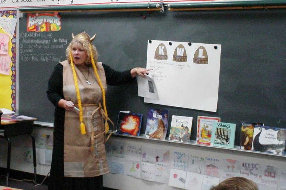 Photo - Clegern Elementary librarian Sherry Park, who is retiring, dresses as a viking to help generate enthusiasm for history among students at the Edmond school. PHOTO PROVIDED